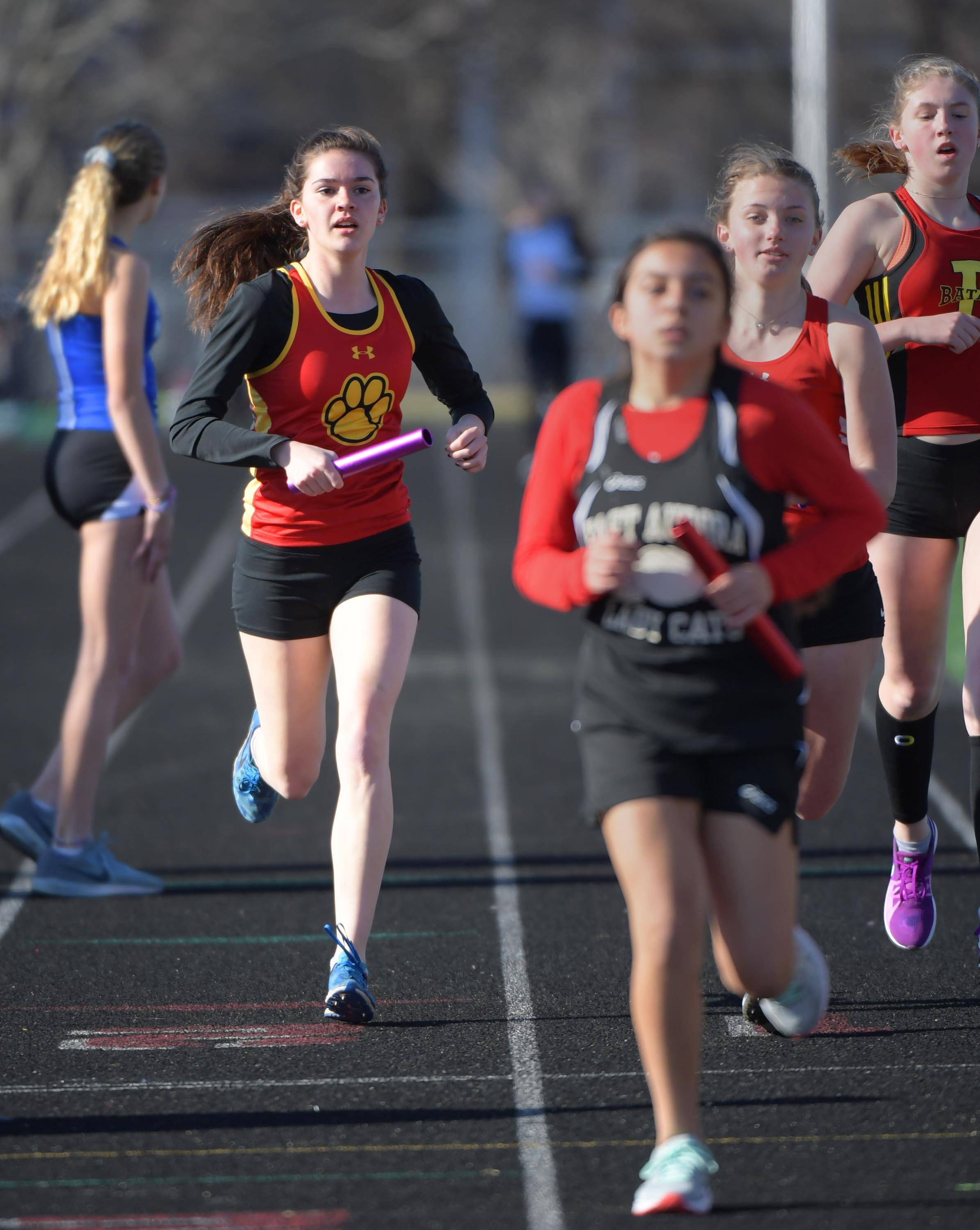Batavia's Erika Mansfield laps slower teams as she anchors the winning 3,200-meter relay team Thursday at the Batavia girls track invitational.