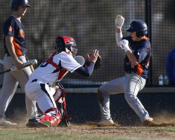 Lake Park Catcher Zach Aehlert Tags Naperville North S Cliff Vickers Who Was Trying To Advance On