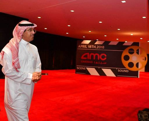"In this Wednesday April 17, 2018 photo, Dr. Awwad Alawwad, the Saudi Minister of Culture and Information, tours the King Abdullah Financial District Theater to follow up on preparations, a day ahead of the first public screening of a commercial film in more than 35 years in Saudi Arabia, in Riyadh Saudi Arabia. Saudi Arabia will hold a private screening of the Hollywood blockbuster ""Black Panther� to herald the launch of movie theaters that are set to open to the public next month. (Center for International Communication via AP)"