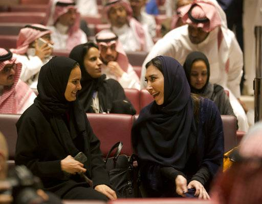 "Visitors laugh as they attend a cinema theatre at an invitation-only screening, at the King Abdullah Financial District Theater, in Riyadh, Saudi Arabia, Wednesday, April 18, 2018. Saudi Arabia held a private screening of the Hollywood blockbuster ""Black Panther� to herald the launch of movie theaters in the kingdom."