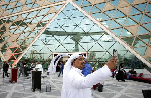 "A visitor takes a selfie with the first cinema theater, at the King Abdullah Financial District Theater, in Riyadh, Saudi Arabia, Wednesday, April 18, 2018. Saudi Arabia will hold a private screening of the Hollywood blockbuster ""Black Panther"" to herald the launch of movie theaters that are set to open to the public next month."