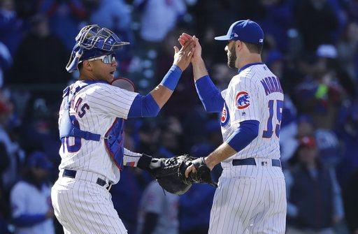 Chicago Cubs catcher Willson Contreras, left, and relief pitcher Brandon Morrow celebrate their win over the St. Louis Cardinals after a baseball game Thursday, April 19, 2018, in Chicago.