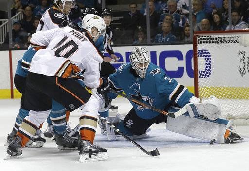 San Jose Sharks goalie Martin Jones, right, defends a shot by Anaheim Ducks right wing Corey Perry (10) during the second period of Game 4 of an NHL hockey first-round playoff series in San Jose, Calif., Wednesday, April 18, 2018.