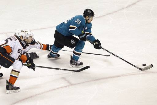 San Jose Sharks center Logan Couture (39) skates in front of Anaheim Ducks defenseman Marcus Pettersson, left, from Sweden, and defenseman Josh Manson during the first period of Game 4 of an NHL hockey first-round playoff series in San Jose, Calif., Wednesday, April 18, 2018.