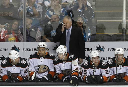 Anaheim Ducks coach Randy Carlyle, center, reacts during the third period of Game 4 of the team's NHL hockey first-round playoff series against the San Jose Sharks in San Jose, Calif., Wednesday, April 18, 2018. The Sharks won 2-1 to sweep the series.