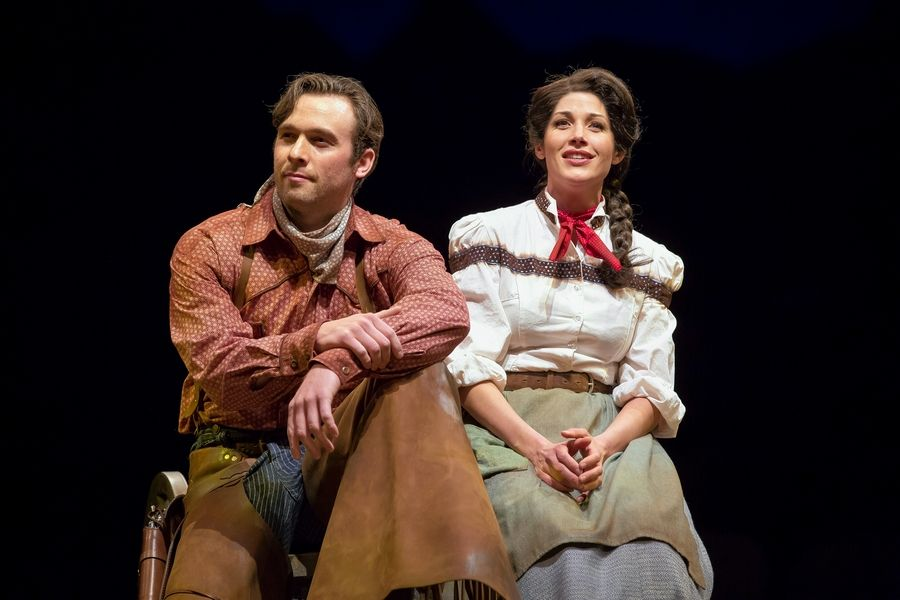"Curly (Brandon Springman) and Laurey (Jennie Sophia) contemplate ""The Surrey with the Fringe on Top"" in the 75th anniversary production of ""Oklahoma!"" at the Marriott Theatre in Lincolnshire."