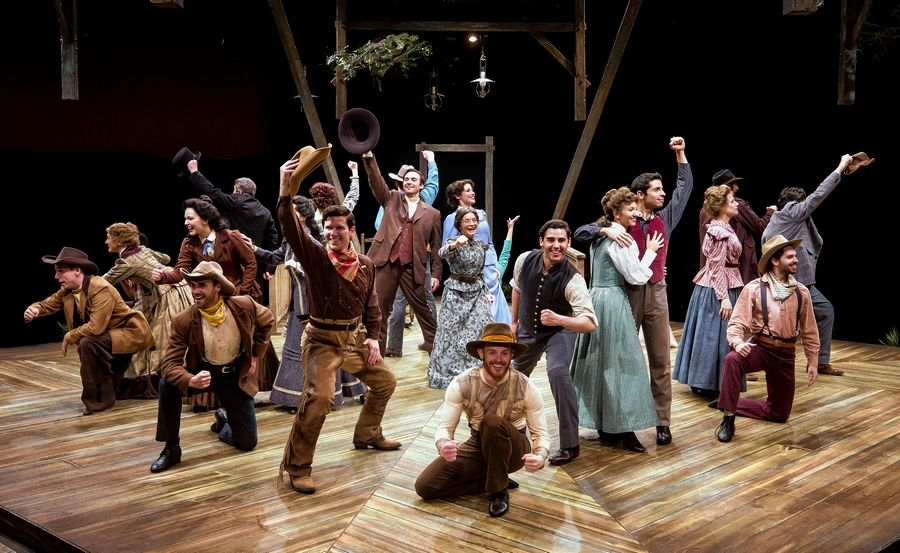 "The ensemble sings the title song of the 75th anniversary production of ""Oklahoma!"" at the Marriott Theatre in Lincolnshire."
