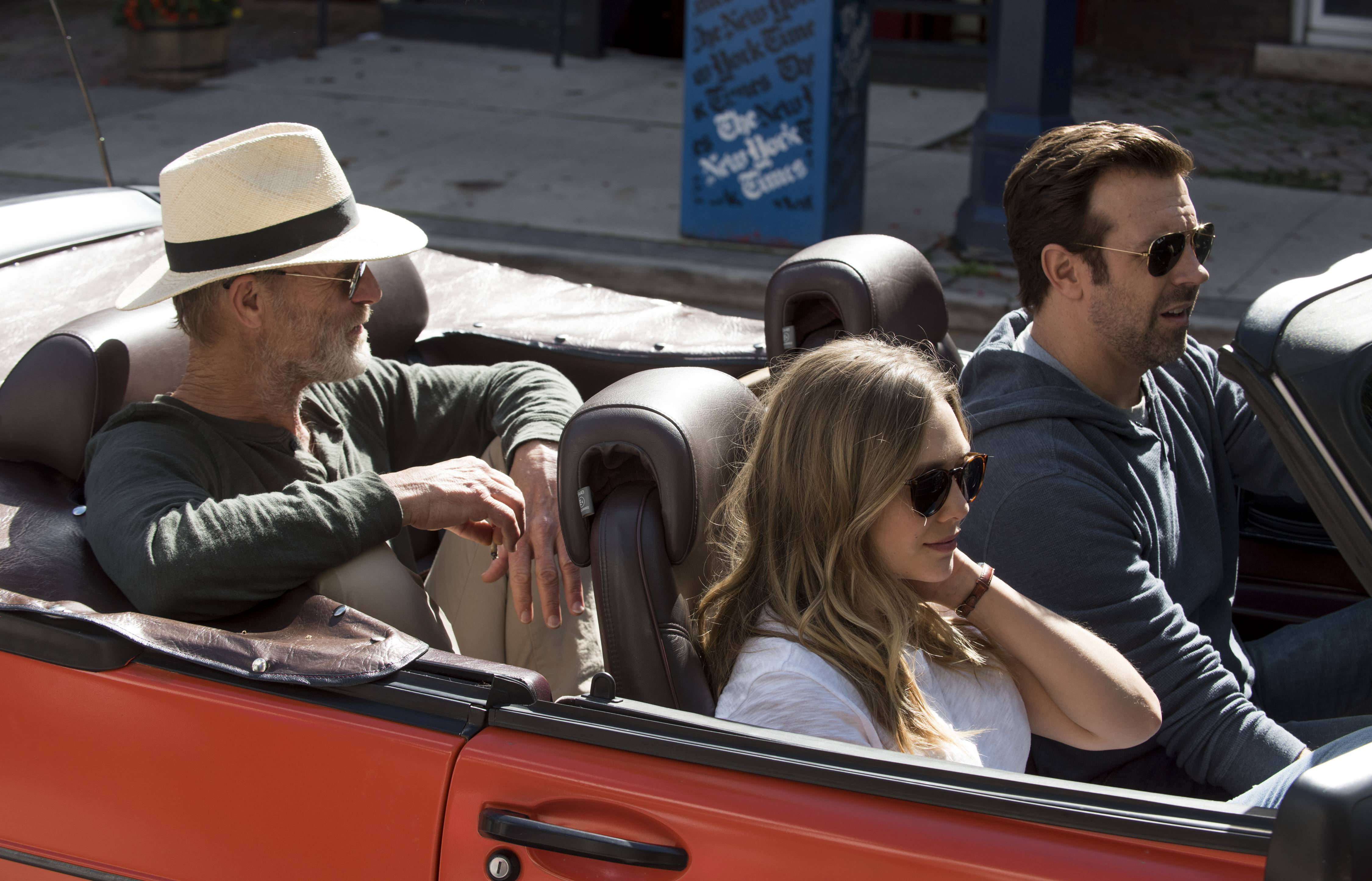 "Matt (Jason Sudeikis), right, takes his father (Ed Harris) and caregiver Zoe (Elizabeth Olsen) on a road trip in ""Kodachrome."""