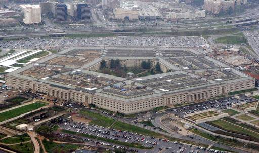 FILE - The Pentagon is seen in this aerial view in Washington, in this March 27, 2008 file photo. The U.S. Army will not meet its mission to recruit 80,000 soldiers this year and has officially lowered the goal. Officials say the service has been able to encourage more experienced service members to stay on the job in order to satisfy the military's growing demand troops. Army officials say the updated goal will be 76,500, and six months into the recruitment year the service has brought in just 28,000 new soldiers. (AP Photo/Charles Dharapak, File)