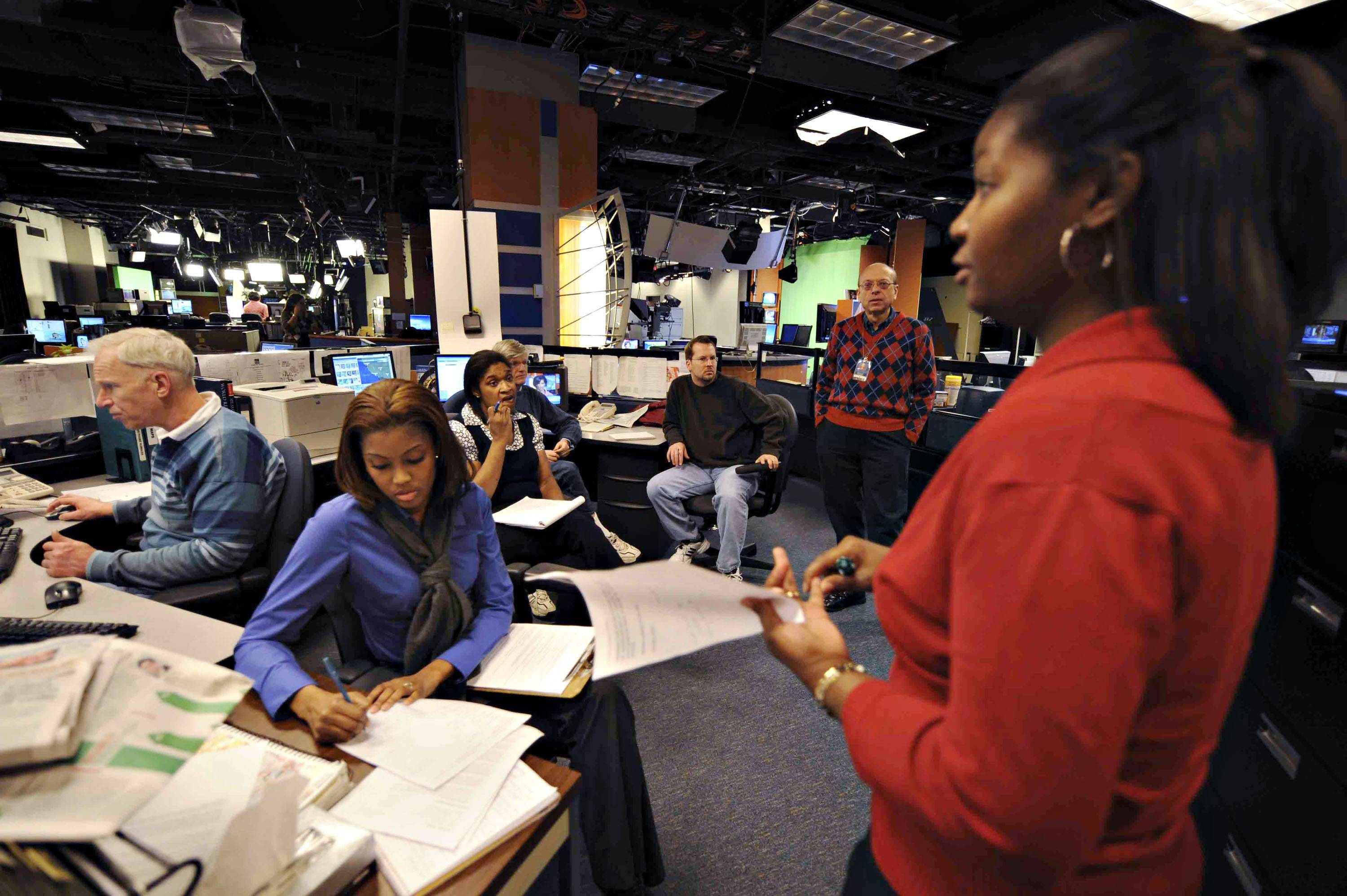 Angie Ballentine discusses the days stories during the 3 p.m. daily production meeting at the Weather Channel Studios on January 3,2008 in Atlanta.