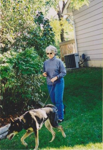 The late Donna Gault, walking the dogs.