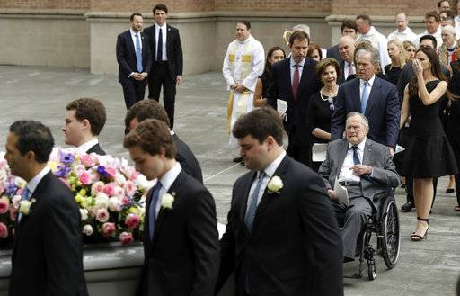 Former President George H.W. Bush and George W. Bush, followed by former first lady Laura Bush follow as pallbearers carry the casket of former first lady Barbara Bush after a funeral service at St. Martin's Episcopal Church, Saturday, April 21, 2018, in Houston.