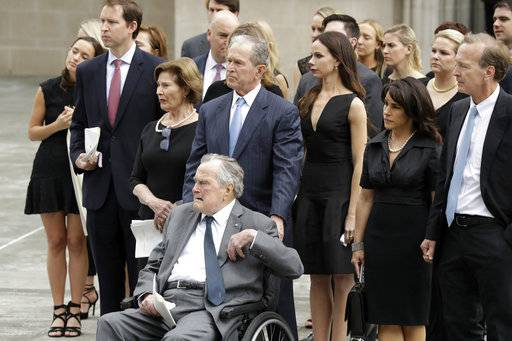 Former Presidents George H.W. Bush and George W. Bush accompanied by their family members watch as pallbearers carry the casket of former first lady Barbara Bush after a funeral service Bush at St. Martin's Episcopal Church, Saturday, April 21, 2018, in Houston.