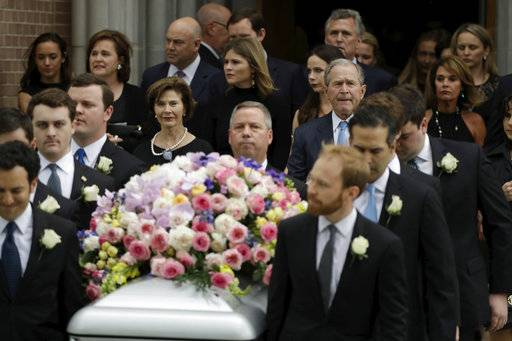 Former President George W. Bush accompanied by former first lady Laura Bush follow as pallbearers carry the casket of former first lady Barbara Bush after a funeral service at St. Martin's Episcopal Church, Saturday, April 21, 2018, in Houston.