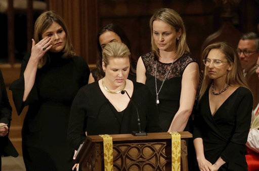 Jenna Bush, left, wipes away tears as granddauters gather to speak during a funeral service for former first lady Barbara Bush at St. Martin's Episcopal Church, Saturday, April 21, 2018, in Houston.
