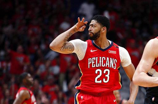 New Orleans Pelicans forward Anthony Davis reacts after making a 3-point shot during the first half of Game 4 of the team's first-round NBA basketball playoff series against the Portland Trail Blazers in New Orleans, Saturday, April 21, 2018.
