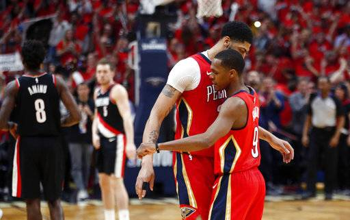New Orleans Pelicans forward Anthony Davis celebrates with guard Rajon Rondo (9) after the Pelicans defeated the Portland Trail Blazers in Game 4 of a first-round NBA basketball playoff series in New Orleans, Saturday, April 21, 2018. The Pelicans won 131-123 to sweep the series.