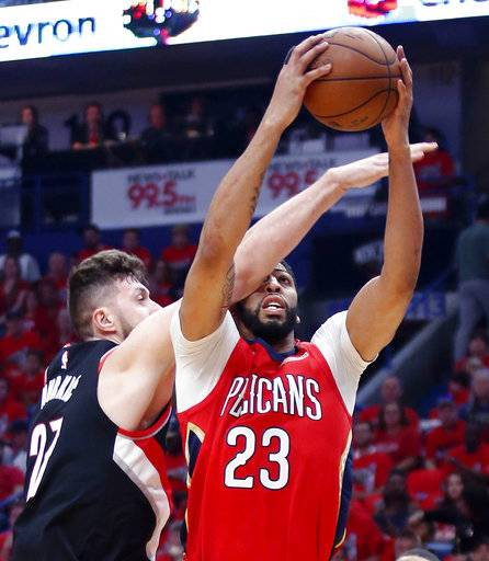 New Orleans Pelicans forward Anthony Davis (23) is fouled by Portland Trail Blazers center Jusuf Nurkic (27) as he drives to the basket during the first half of Game 4 of a first-round NBA basketball playoff series in New Orleans, Saturday, April 21, 2018.