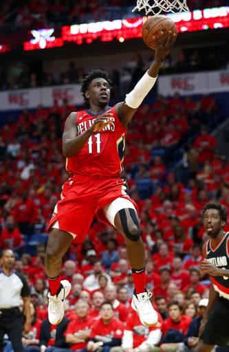 New Orleans Pelicans guard Jrue Holiday (11) goes to the basket during the first half of Game 4 of a first-round NBA basketball playoff series against the Portland Trail Blazers in New Orleans, Saturday, April 21, 2018.
