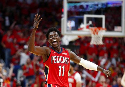 New Orleans Pelicans guard Jrue Holiday (11) gestures during the first half of Game 4 of the team's first-round NBA basketball playoff series against the Portland Trail Blazers in New Orleans, Saturday, April 21, 2018.