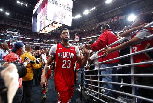 New Orleans Pelicans forward Anthony Davis (23) greets fans after defeating the Portland Trail Blazers in Game 4 of a first-round NBA basketball playoff series in New Orleans, Saturday, April 21, 2018.