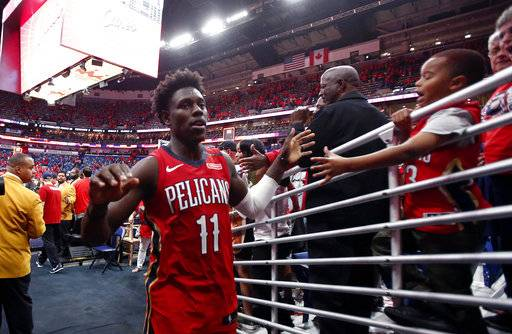 New Orleans Pelicans guard Jrue Holiday (11) greets fans after the Pelicans defeated the Portland Trail Blazers 131-123 in Game 4 of a first-round NBA basketball playoff series in New Orleans, Saturday, April 21, 2018. The Pelicans swept the series.