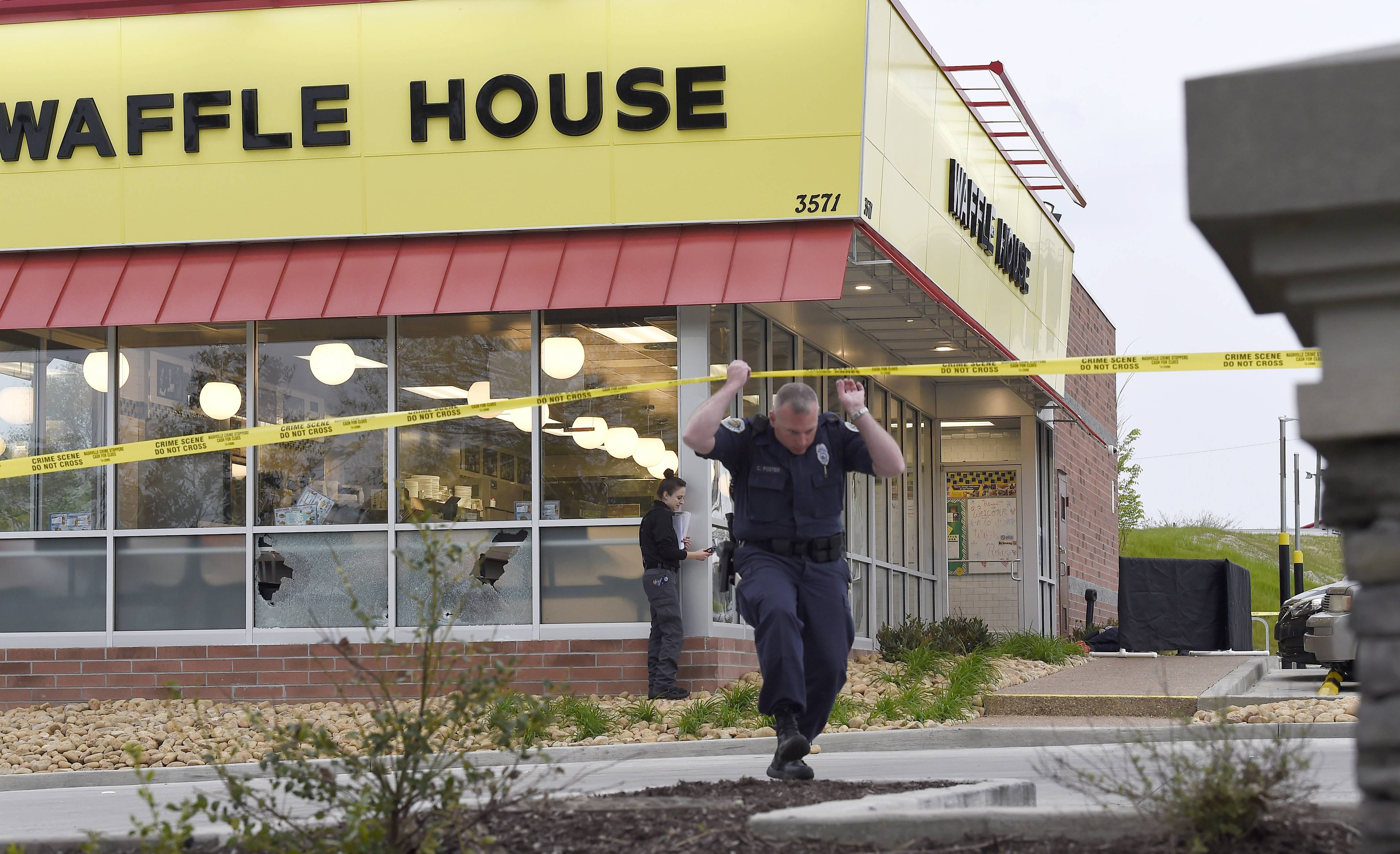 Law enforcement officials work the scene of a fatal shooting at a Waffle House in the Antioch neighborhood of Nashville, Sunday.