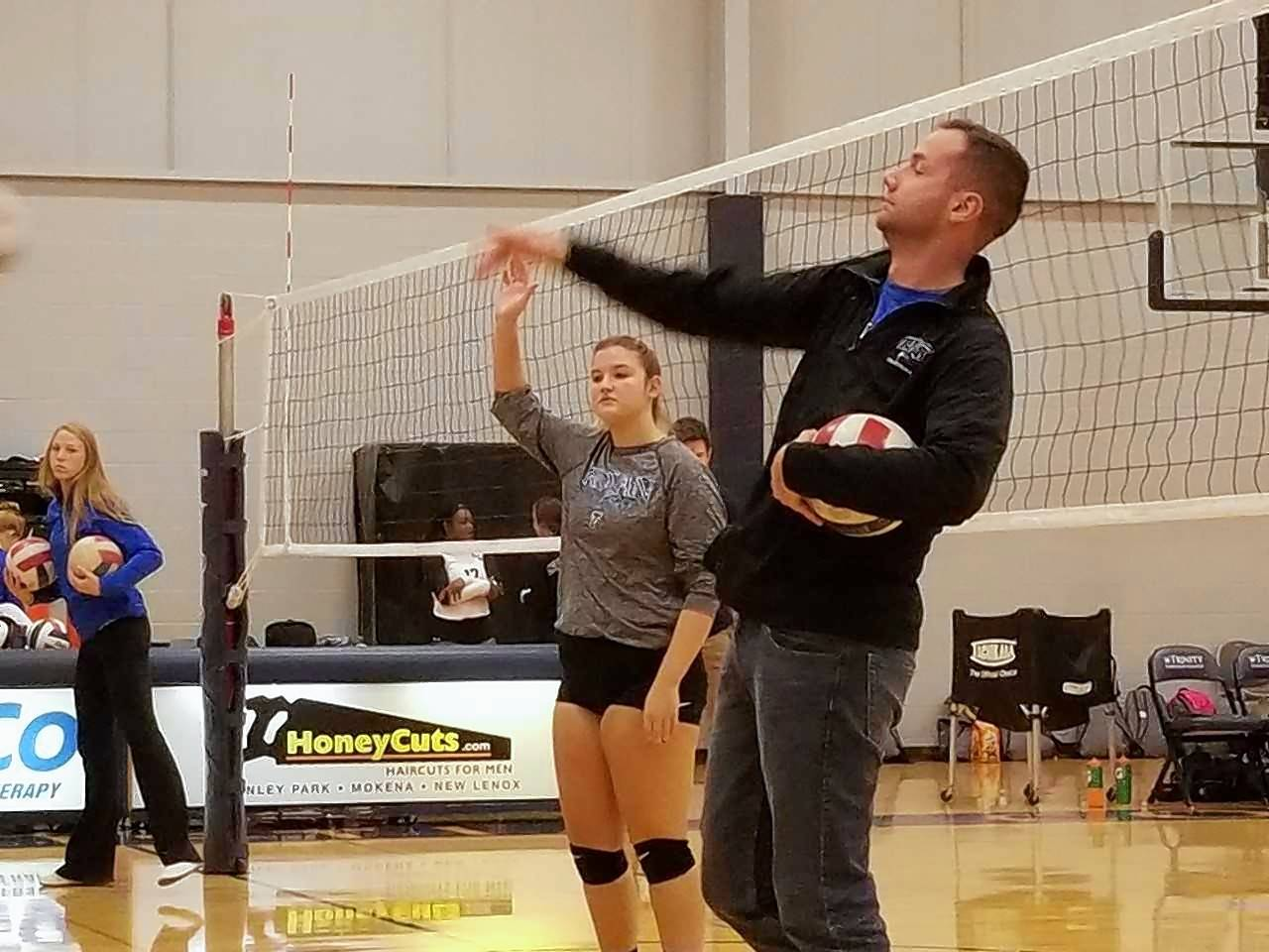 Katelyn Sommers warms up along side her Trinity coach, Luke Ward. Sommers was named team MVP this season.