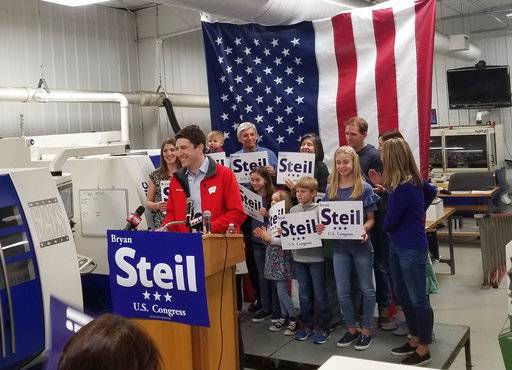 Attorney Bryan Steil, a former driver for House Speaker Paul Ryan, announces he is running to succeed Ryan in Congress, Sunday, April 22, 2018, in Janesville, Wis. (Jake Magee/The Janesville Gazette via AP)