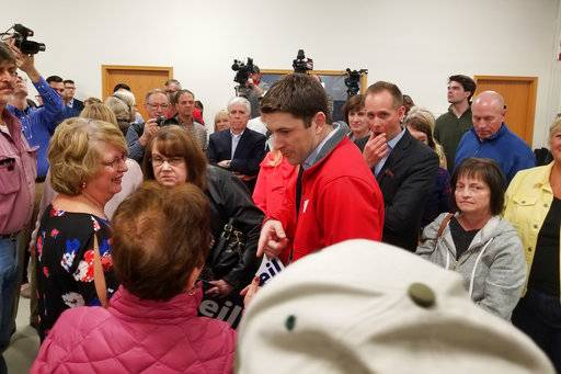Attorney Bryan Steil, center, a former driver for House Speaker Paul Ryan, talks to people gathered at a news conference where he announced he is running to succeed Ryan in Congress, Sunday, April 22, 2018, in Janesville, Wis. (Jake Magee/The Janesville Gazette via AP)