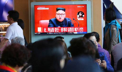 "FILE - In this April 21, 2018 file photo, people watch a TV screen showing an image of North Korean leader Kim Jong Un during a news program at the Seoul Railway Station in Seoul, South Korea. The signs read: ""North Korea says it has suspended nuclear tests."" North Korea's abrupt diplomatic outreach in recent months comes after a flurry of weapons tests that marked 2017, including the underground detonation of an alleged thermonuclear warhead and three launches of developmental ICBMs designed to strike the U.S. mainland. Inter-Korean dialogue resumed after Kim in his New Year's speech proposed talks with the South to reduce animosities and for the North to participate in February's Winter Olympics in Pyongchang. North Korea sent hundreds of people to the games, including Kim's sister, who expressed her brother's desire to meet with Moon for a summit. South Korean officials later brokered a potential summit between Kim and Trump. (AP Photo/Ahn Young-joon, File)"