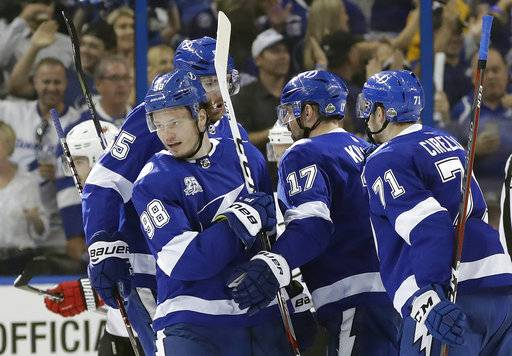 Tampa Bay Lightning defenseman Mikhail Sergachev (98) celebrates after his goal against the New Jersey Devils with teammates, including Alex Killorn (17) and center Anthony Cirelli (71) during the first period of Game 5 of an NHL first-round hockey playoff series Saturday, April 21, 2018, in Tampa, Fla.