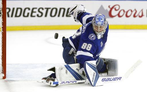 Tampa Bay Lightning goaltender Andrei Vasilevskiy (88) makes a save on a shot by the New Jersey Devils during the first period of Game 5 of an NHL first-round hockey playoff series Saturday, April 21, 2018, in Tampa, Fla.