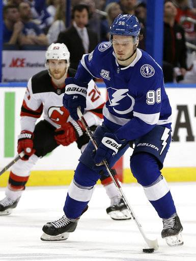 Tampa Bay Lightning defenseman Mikhail Sergachev (98) carries the puck past New Jersey Devils center Blake Coleman (20) during the second period of Game 5 of an NHL first-round hockey playoff series Saturday, April 21, 2018, in Tampa, Fla.