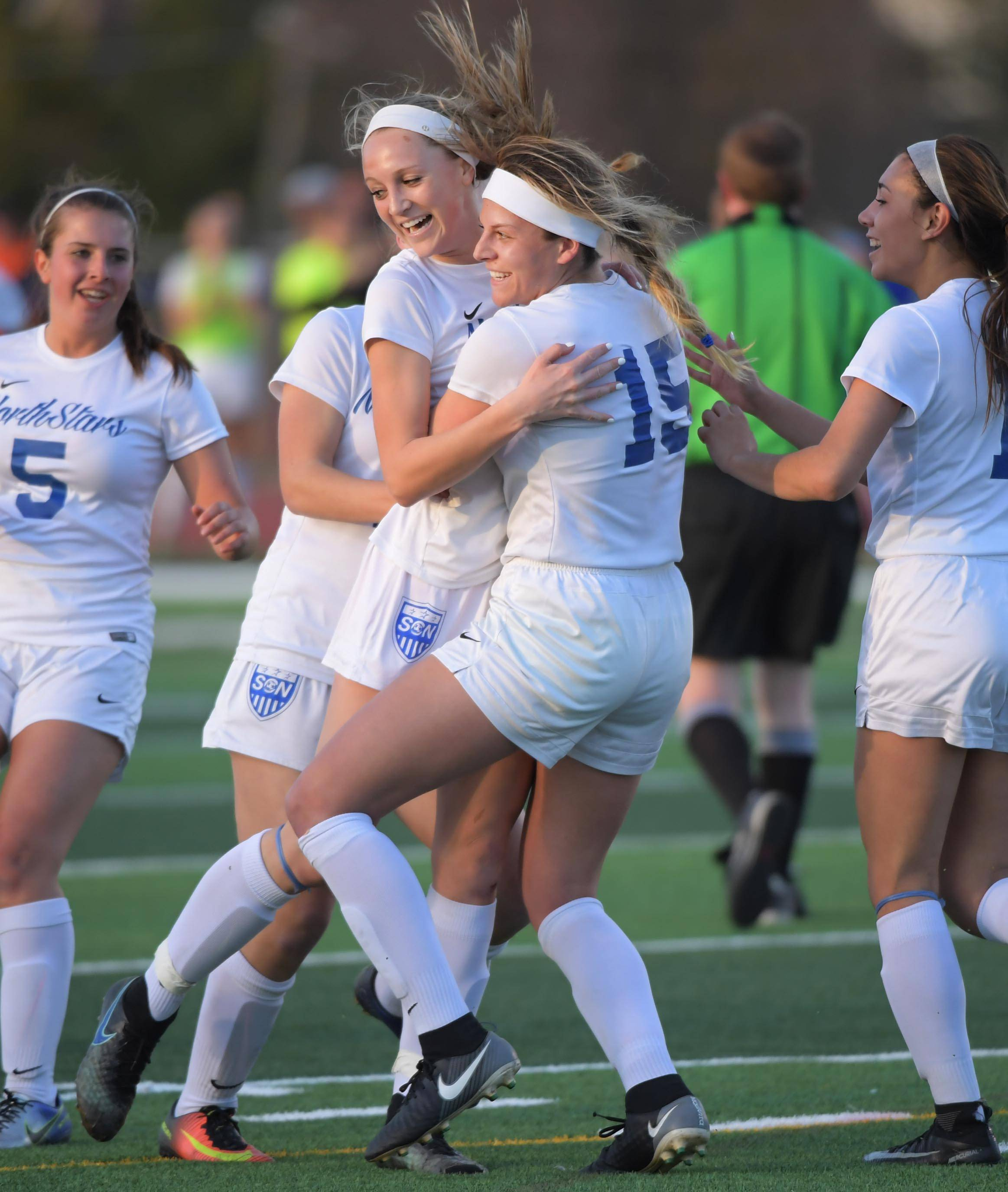 St. Charles North's Gia Wahlberg and teammate Hailey Rydberg, left, celebrate Wahlberg's first goal against St. Charles East in a girls soccer game at North High School Tuesday.