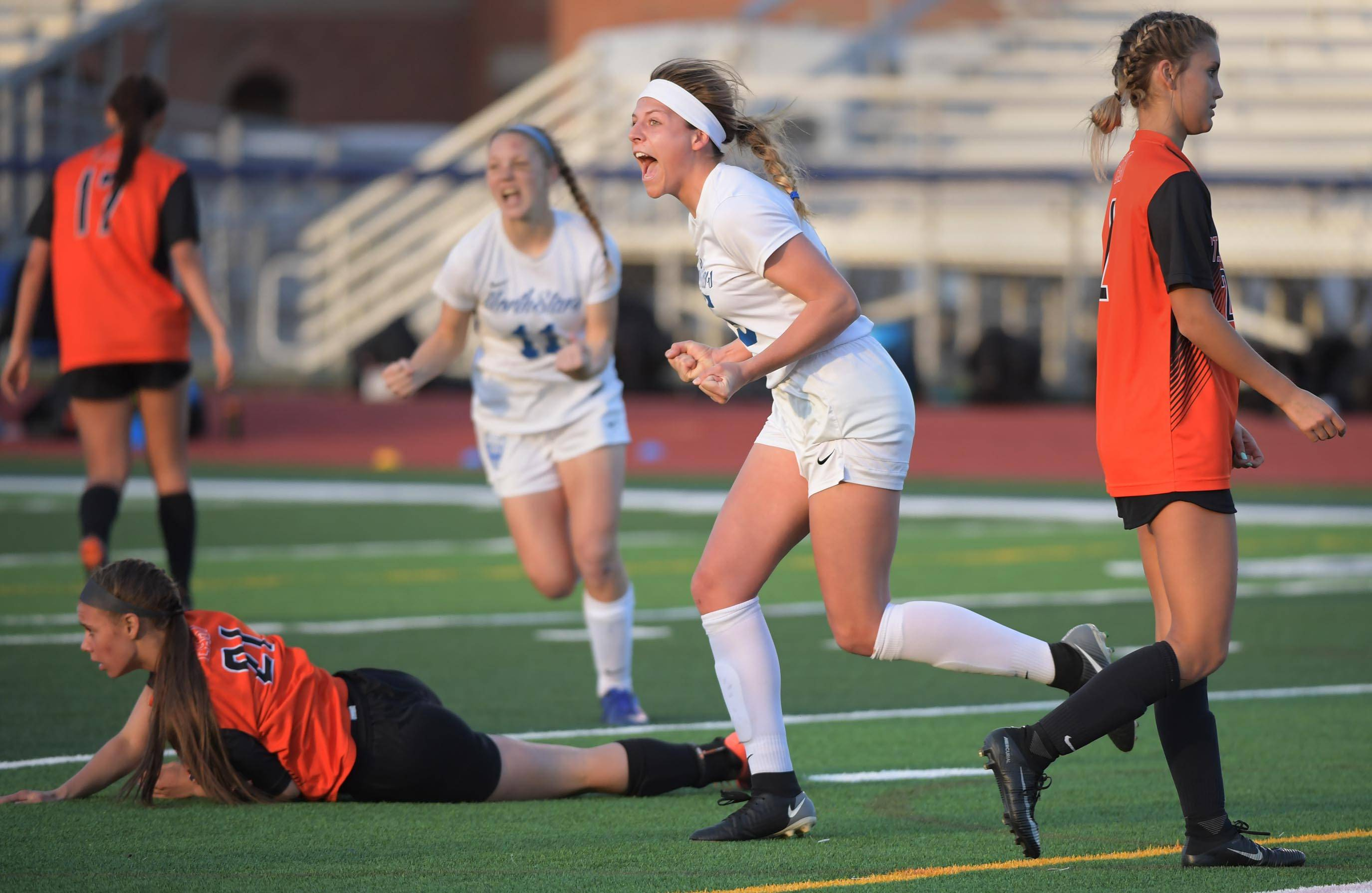 St. Charles North's Gia Wahlberg celebrates her first goal against St. Charles East in a girls soccer game at North High School Tuesday.