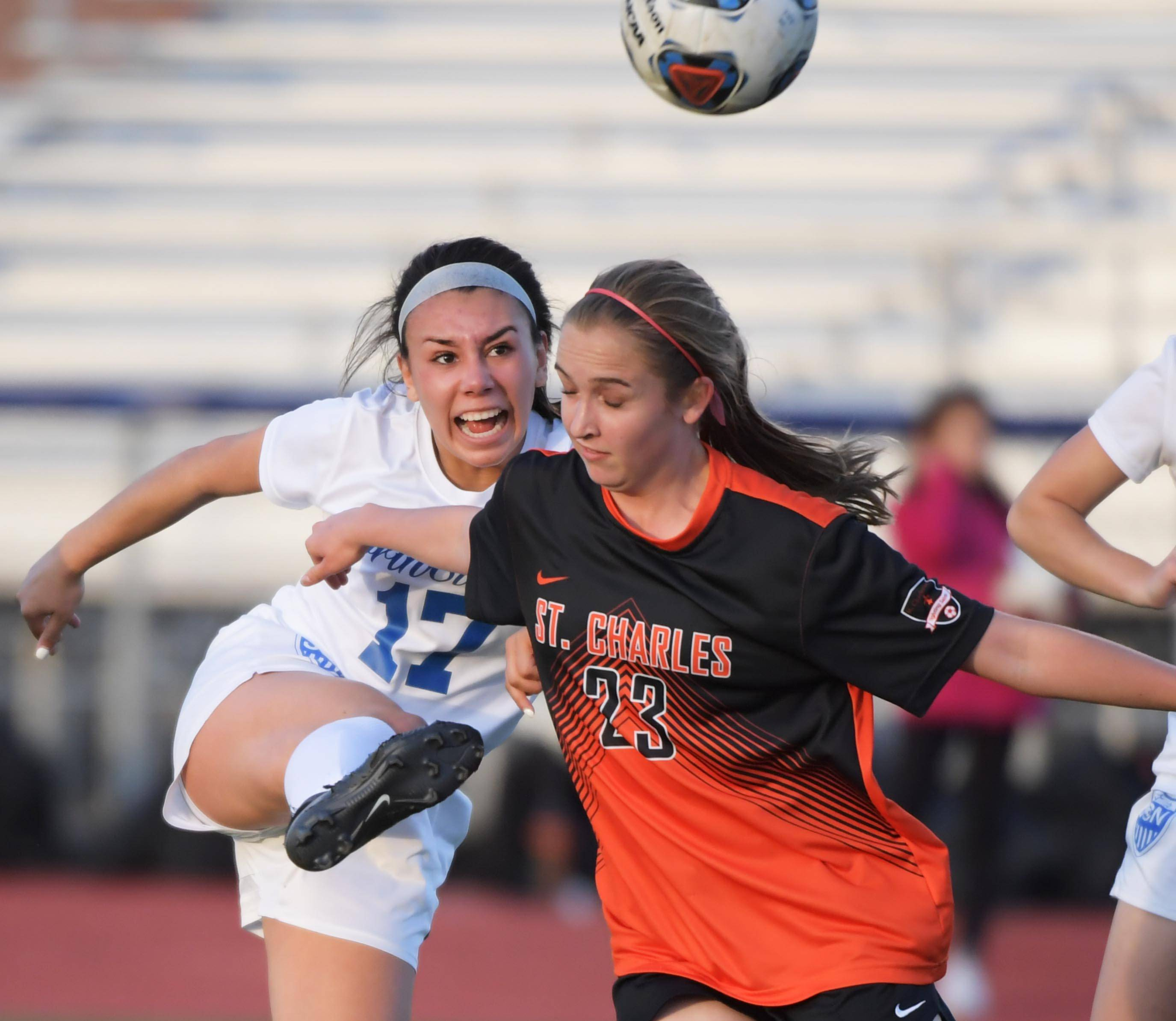 St. Charles North's Claudia Najera unleashes a high kick against St. Charles East's Lindsey Rzeszutko in a girls soccer game at North High School Tuesday.