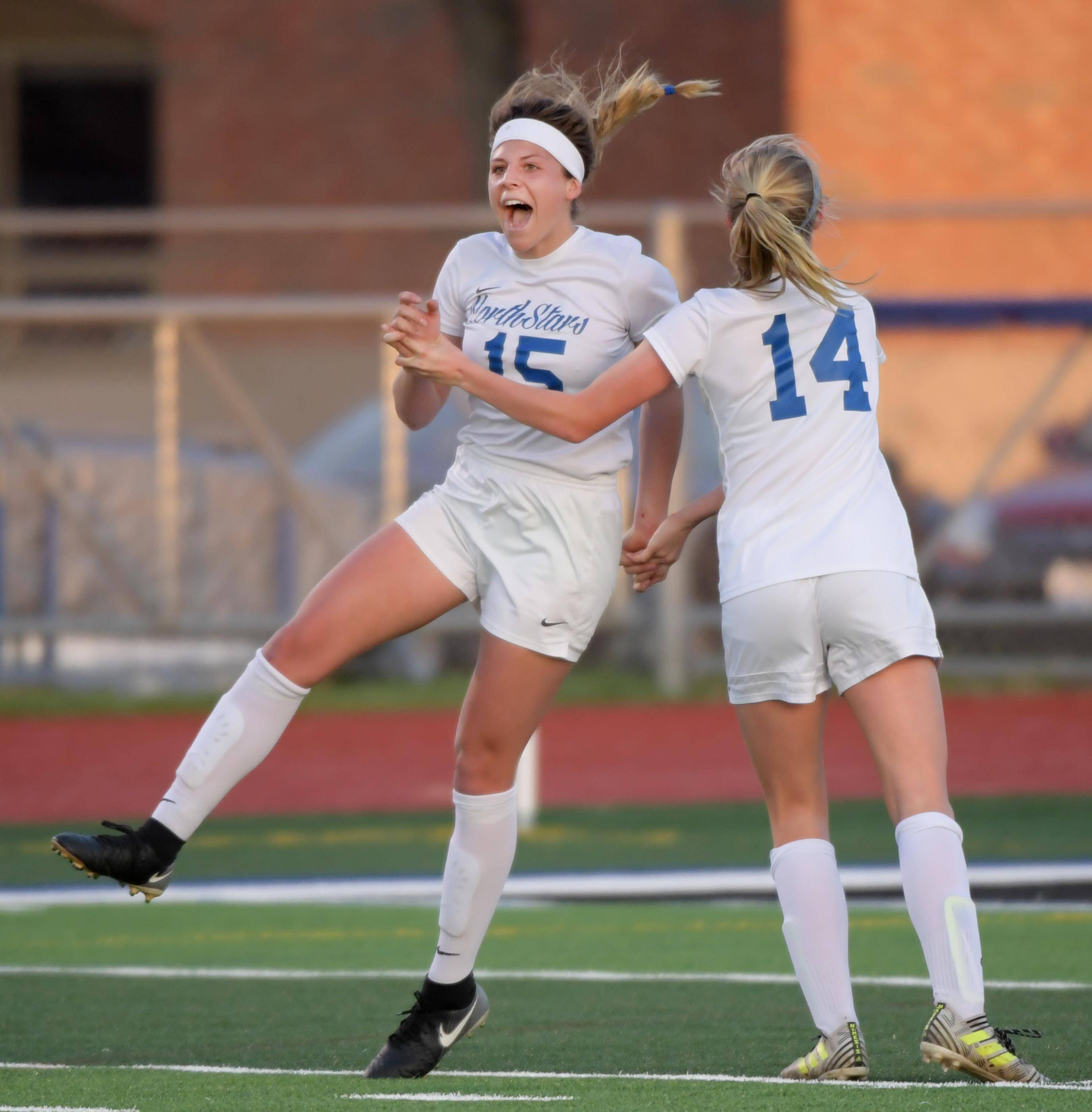 St. Charles North's Gia Wahlberg celebrates her second goal against St. Charles East with teammate Chloe Netzel in a girls soccer game at North High School Tuesday.