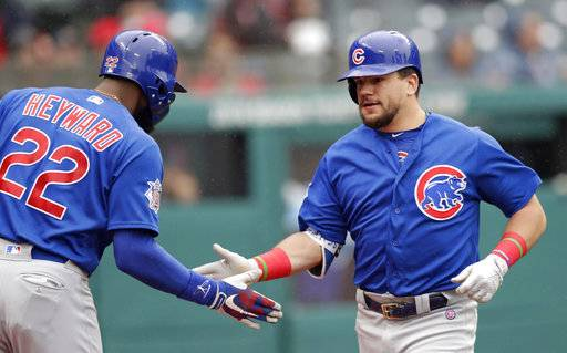 Chicago Cubs' Kyle Schwarber, right, is congratulated by Jason Heyward after Schwarber hit a solo home run off Cleveland Indians starting pitcher Josh Tomlin in the second inning of a baseball game, Tuesday, April 24, 2018, in Cleveland. (AP Photo/Tony Dejak)