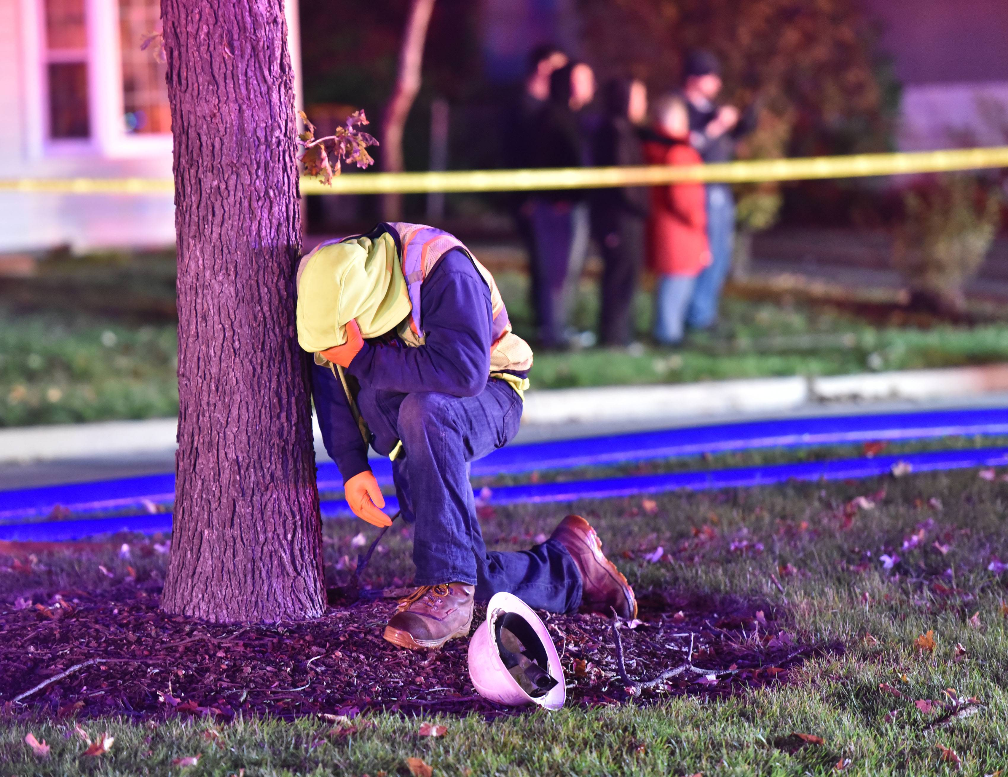 In this photo from October 2017, a man reacts after crews pulled a worker from a sewer line on South Park Boulevard in Streamwood.