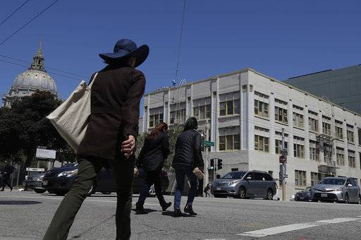 Pedestrians cross the intersection of Hayes Street and Van Ness Avenue in San Francisco, Wednesday, April 25, 2018. The San Francisco Conservatory of Music plans to start construction this summer of a 12-floor building containing two concert halls in an area that already includes City Hall, the San Francisco Opera and the San Francisco Symphony's Davies Hall.