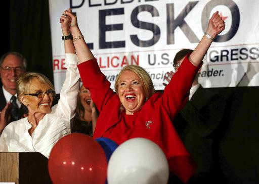 Republican U.S. Congressional candidate Debbie Lesko, right, celebrates her win with former Arizona Gov. Jan Brewer at her home, Tuesday, April 24, 2018, in Peoria, Ariz. Lesko ran against Democratic candidate Hiral Tipirneni for Arizona's 8th Congressional District seat being vacated by U.S. Rep. Trent Franks, R-Arizona. (AP Photo/Matt York)