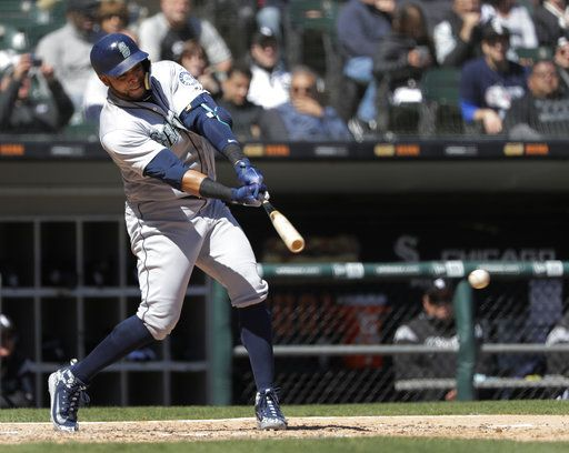 Seattle Mariners' Nelson Cruz hits an RBI single off Chicago White Sox starting pitcher James Shields during the fifth inning of a baseball game Wednesday, April 25, 2018, in Chicago. Daniel Vogelbach scored on the play.