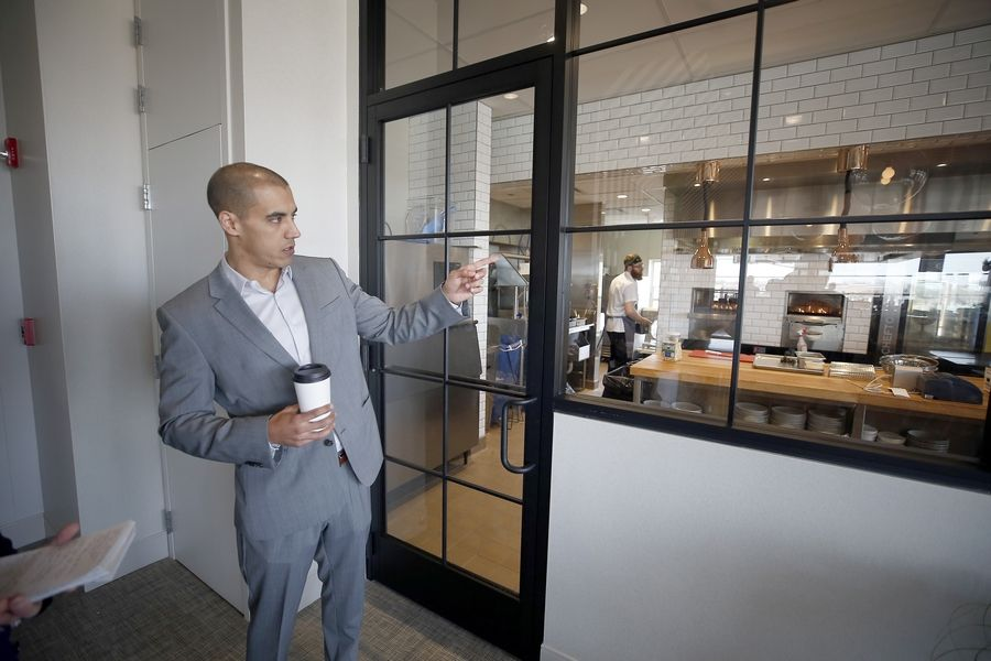 Julio Cano, chief business officer of Santo Cielo, talks about the fourth restaurant by the Bien Trucha Group, which is set to open May 2 atop the Hotel Indigo in the Water Street District in downtown Naperville.