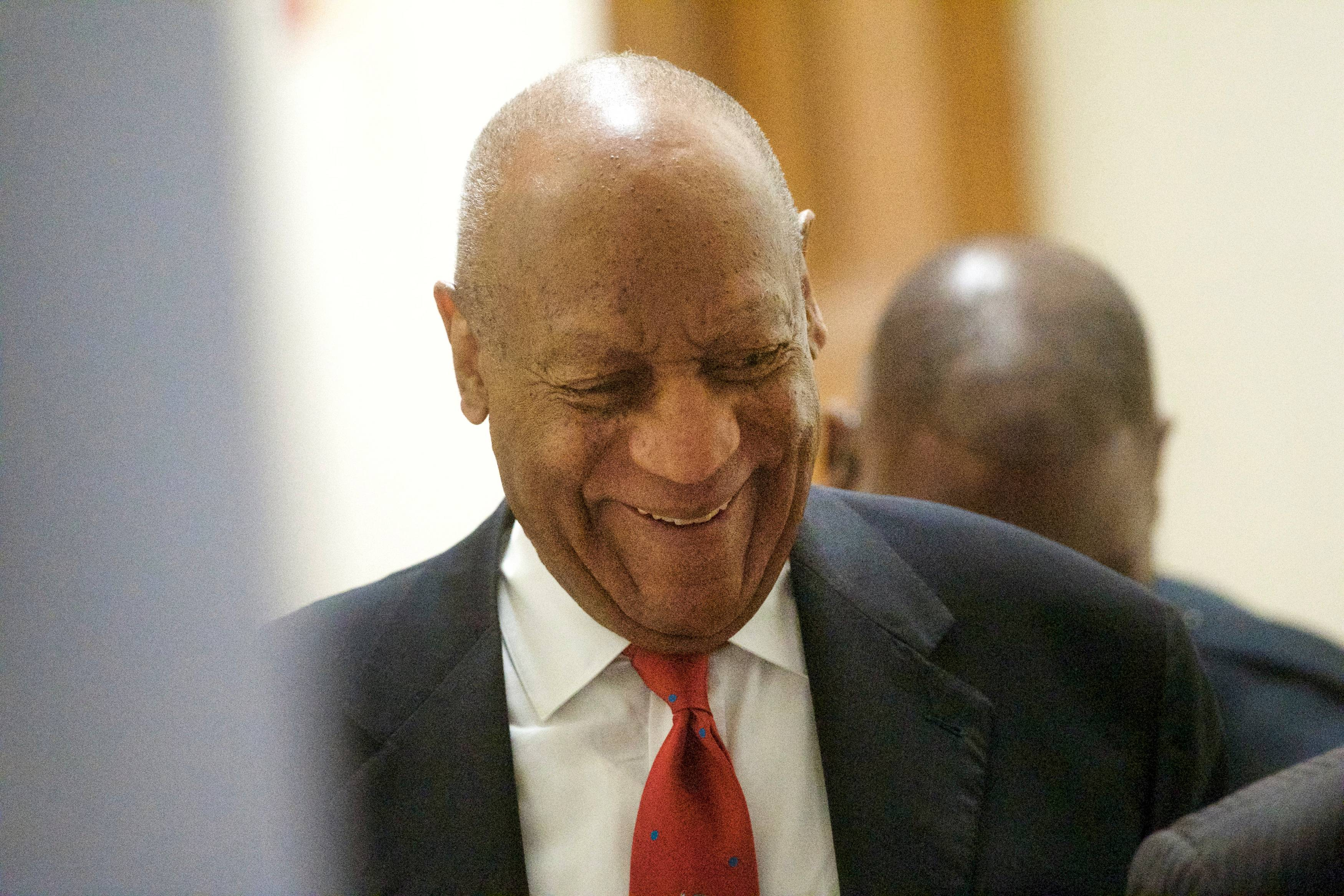 Actor and comedian Bill Cosby walks through the Montgomery County Courthouse as he arrives Thursday for jury deliberations in his sexual assault retrial in Norristown, Pa.