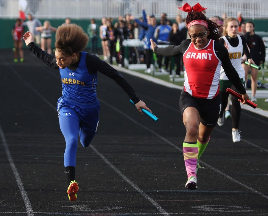 Warren's Janii Jenkins, left, edges Grant's Ariyona Wallace at the finish of the 4x100 relay during the Lake County girls track meet Thursday at Grayslake Central.