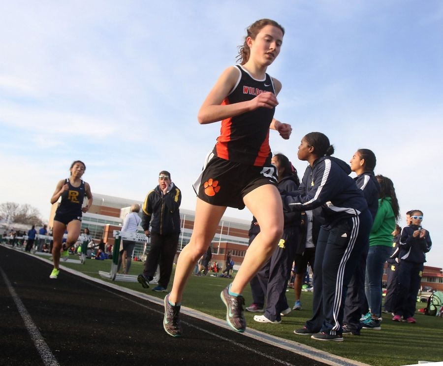 Libertyville's Melissa Manetsch leads Round Lake's Fatima Giron in the 3200-meter run during the Lake County meet.