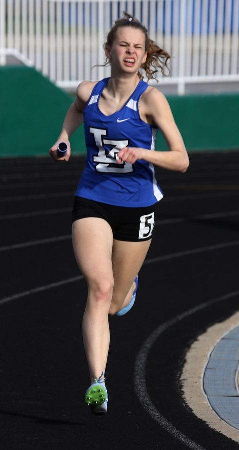 Laker Zurich's Hayley Burk leads in the 4x800 relay during the Lake County meet Thursday at Grayslake Central.