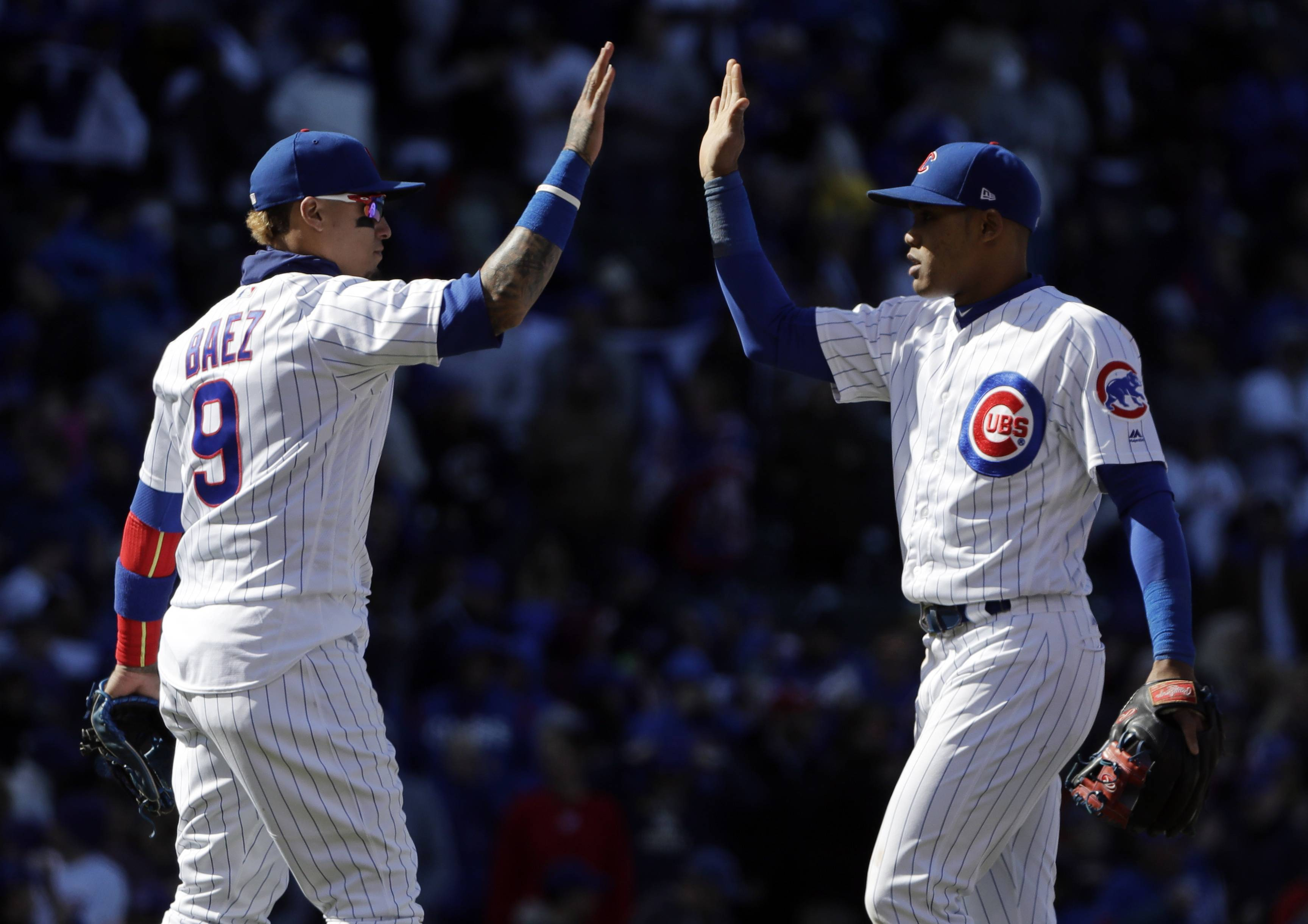 The Cubs' Javier Baez, left, celebrates with Addison Russell after they defeated the Milwaukee Brewers on Sunday at Wrigley Field.