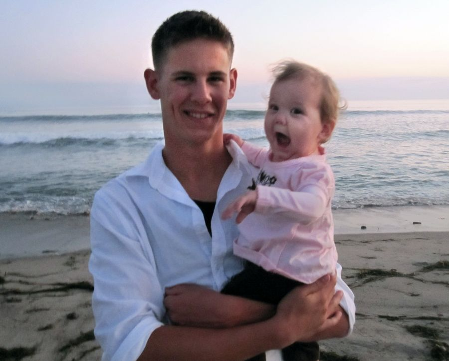 Marine Lance Cpl. James Stack with his daughter then 1-year-old daughter, Mikayla, at Camp Pendleton beach in California. Stack was killed in Afghanistan in 2010.